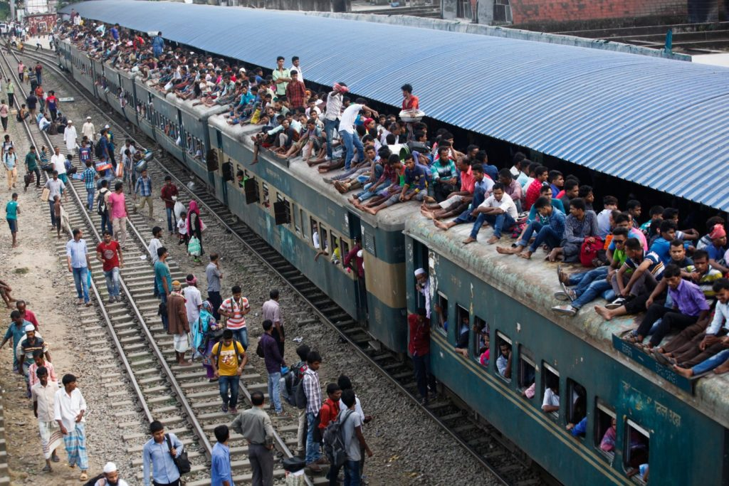 People leave for villages by train ahead of the the upcoming religious festival Eid-ul-Adha at Airport railway station in Dhaka. The capital city of Bangladesh has more than 18 million citizens living there and is considered the most densely populated city on the planet. Each year, huge numbers of people go to back home to their home villages to celebrate Eid.